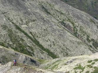 Chugach and Talkeetna Mountains in Alaska. Woman on mountainside.