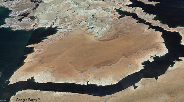 Google Earth™ aerial image of an arid peninsula surrounded by water.