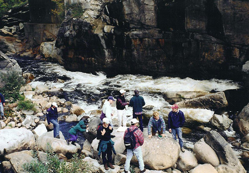 Students study the rocks during field camp.