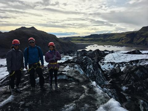 Family of three, photographed while hiking the Sólheimajökull glacier in Iceland