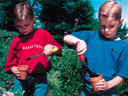 Image of boys potting plants