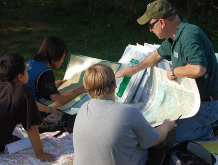 Image of students looking at maps