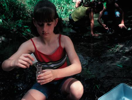 Image of student conducting water testing